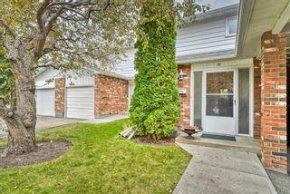 Photo 1: 21 2815 Palliser Drive SW in Calgary: Oakridge Row/Townhouse for sale : MLS®# A1149195