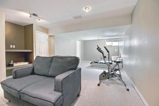 Photo 33: 403 950 Arbour Lake Road NW in Calgary: Arbour Lake Row/Townhouse for sale : MLS®# A1140525