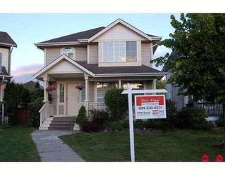 Photo 1: 18480 65A Avenue in Surrey: Cloverdale BC House for sale (Cloverdale)  : MLS®# F2715644