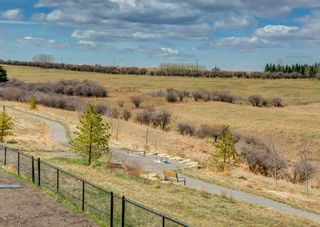 Photo 2: 203 Crestridge Hill SW in Calgary: Crestmont Detached for sale : MLS®# A1105863