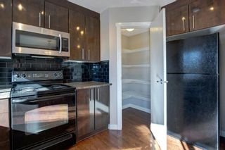 Photo 12: 106 2445 Kingsland Road SE: Airdrie Row/Townhouse for sale : MLS®# A1072510