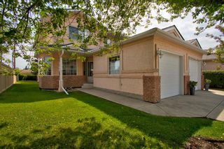 Main Photo: 252 SCENIC ACRES Terrace NW in Calgary: Scenic Acres Row/Townhouse for sale : MLS®# A1142315