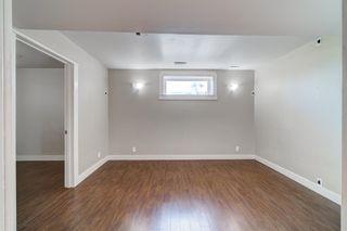 Photo 35: 4 136 Bow Ridge Drive: Cochrane Row/Townhouse for sale : MLS®# A1116097