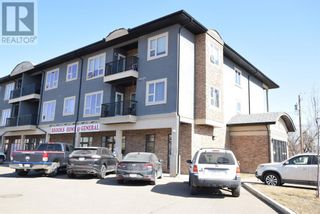 Photo 2: 17, 330 2 Street W in Brooks: Condo for sale : MLS®# A1096698