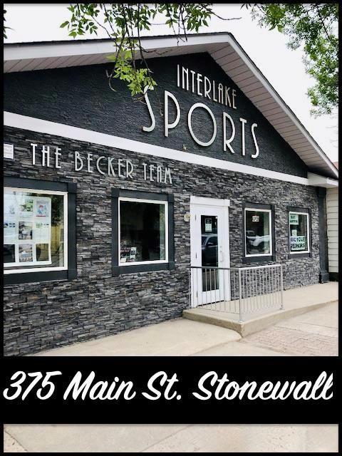 Sport shop business, building, & land for sale.
