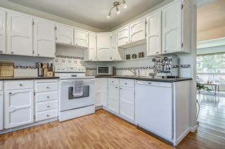 Photo 11: 71 5625 Silverdale Drive NW in Calgary: Silver Springs Row/Townhouse for sale : MLS®# A1142197