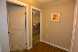 """Photo 13: 8 3664 THIRD Avenue in Smithers: Smithers - Town Condo for sale in """"Cornerstone Place"""" (Smithers And Area (Zone 54))  : MLS®# R2588487"""