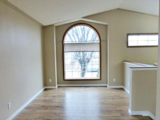 Photo 3: 107 Mt Allan Circle SE in Calgary: McKenzie Lake Detached for sale : MLS®# A1068557