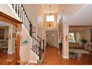 Photo 30: 148 GLENEAGLES Close: Cochrane House for sale : MLS®# C4010996