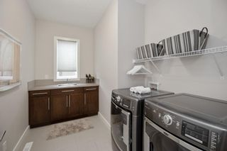 Photo 44: 204 ASCOT Crescent SW in Calgary: Aspen Woods Detached for sale : MLS®# A1025178