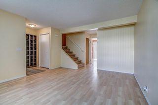 Photo 5: 145 WOODSMAN Lane SW in Calgary: Woodbine Row/Townhouse for sale : MLS®# C4303483