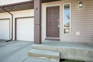 Photo 1: 8 Everridge Gardens SW in Calgary: Evergreen Row/Townhouse for sale : MLS®# A1041120