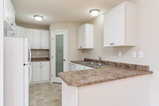 Photo 1: 101 10502 101 Avenue: Morinville Condo for sale : MLS®# E4265213