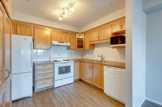 Photo 7: 3111 200 Community Way: Okotoks Apartment for sale : MLS®# A1142696