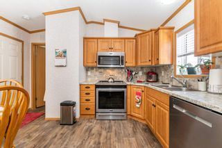 """Photo 10: 113 6338 VEDDER Road in Chilliwack: Sardis East Vedder Rd Manufactured Home for sale in """"MAPLE MEADOWS"""" (Sardis)  : MLS®# R2604784"""