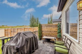 Photo 33: 105 Rainbow Falls Boulevard: Chestermere Semi Detached for sale : MLS®# A1144465