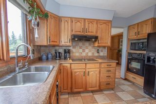Photo 11: 47 Ranch Estates Road NW in Calgary: Ranchlands Detached for sale : MLS®# A1142051