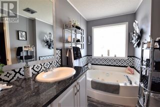 Photo 13: 9 Meadowplace Green in Brooks: House for sale : MLS®# A1145221