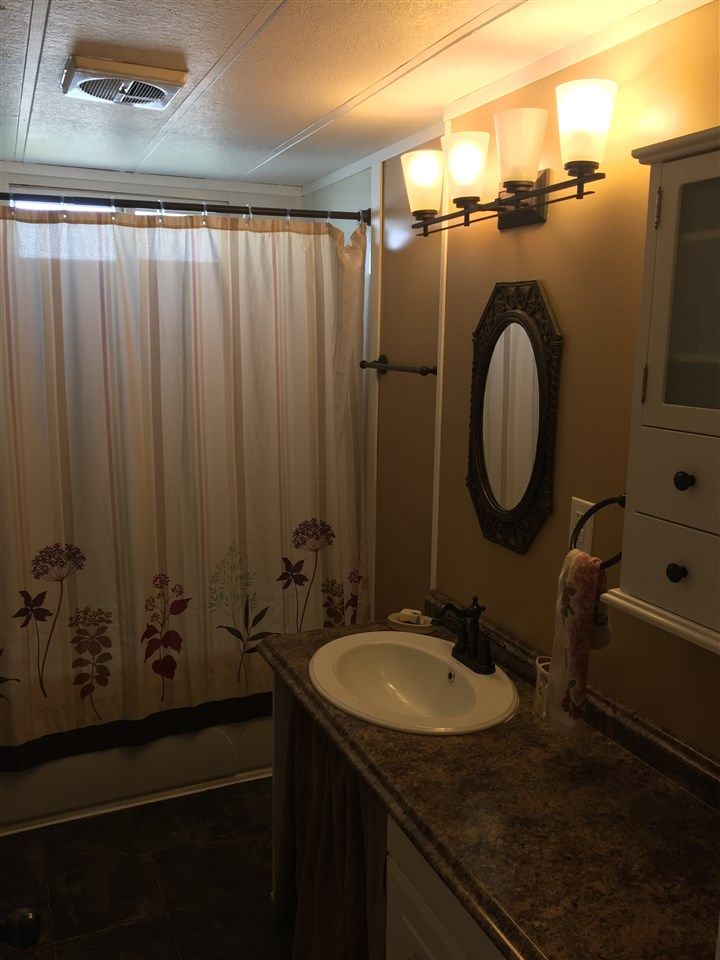"""Photo 13: Photos: 41 8420 ALASKA Road in Fort St. John: Fort St. John - City SE Manufactured Home for sale in """"PEACE COUNTRY MOBILE HOME PARK"""" (Fort St. John (Zone 60))  : MLS®# R2069792"""