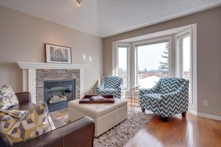 Photo 2: 52 100 Signature Way SW in Calgary: Signal Hill Semi Detached for sale : MLS®# A1100038