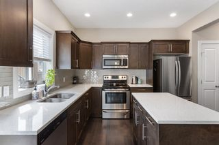 Photo 3:  in Calgary: Winston Heights/Mountview Row/Townhouse for sale : MLS®# A1105103
