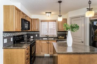 Photo 6: 27 Auburn Bay Manor SE in Calgary: Auburn Bay Detached for sale : MLS®# A1073937