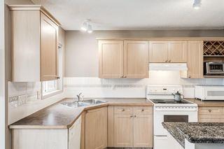 Photo 11: 324 Rocky Ridge Drive NW in Calgary: Rocky Ridge Detached for sale : MLS®# A1124586