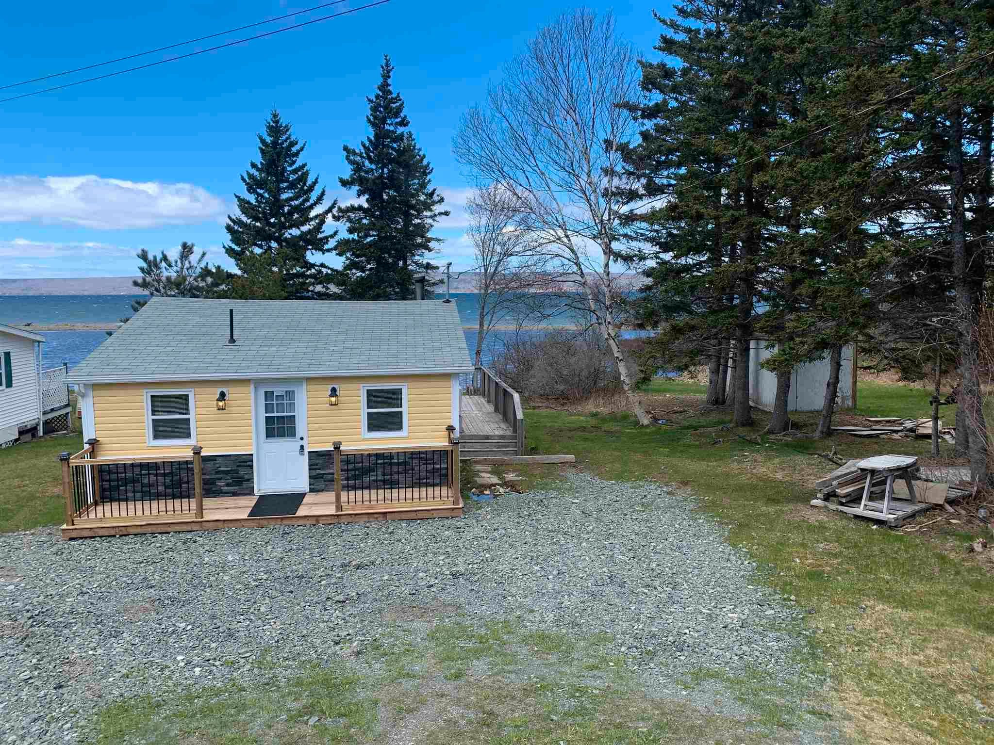 Main Photo: 7542 East Bay Highway in Big Pond: 207-C. B. County Residential for sale (Cape Breton)  : MLS®# 202110775