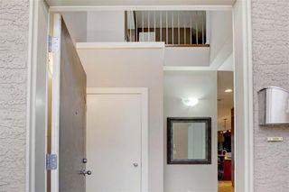 Photo 2: 254 21 Avenue NE in Calgary: Tuxedo Park Semi Detached for sale : MLS®# C4275757