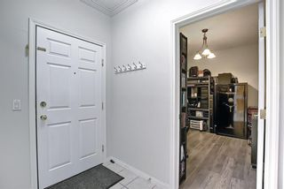 Photo 4: 303 495 78 Avenue SW in Calgary: Kingsland Apartment for sale : MLS®# A1120349