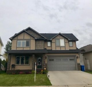 Photo 1: 734 Stonehaven Drive: Carstairs Detached for sale : MLS®# C4270012