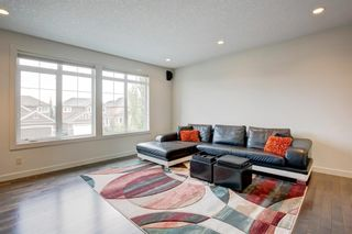 Photo 12: 127 Springbluff Boulevard SW in Calgary: Springbank Hill Detached for sale : MLS®# A1140601