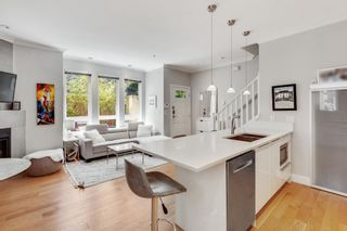 """Main Photo: 1638 ARBUTUS Street in Vancouver: Kitsilano Townhouse for sale in """"KITSILANO MEWS"""" (Vancouver West)  : MLS®# R2597236"""