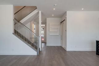 Photo 5: 154 69 Street SW in Calgary: Strathcona Park Residential for sale : MLS®# A1054727