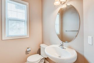 Photo 11: 100 28 Heritage Drive: Cochrane Row/Townhouse for sale : MLS®# A1076913