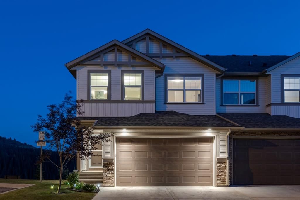 Main Photo: 157 Sunset Point: Cochrane Row/Townhouse for sale : MLS®# A1132458