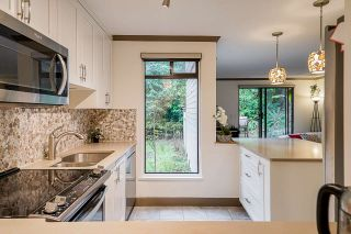 Photo 1: 103 9125 CAPELLA DRIVE in Burnaby: Simon Fraser Hills Townhouse for sale (Burnaby North)  : MLS®# R2560359