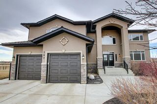 Photo 2: 167 COVE Close: Chestermere Detached for sale : MLS®# A1090324