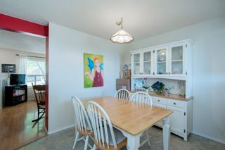 Photo 16: 332 Queenston Heights SE in Calgary: Queensland Row/Townhouse for sale : MLS®# A1114442