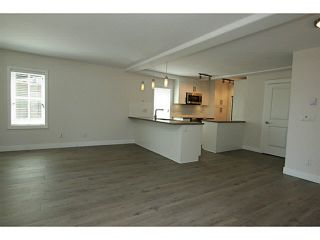 """Photo 3: 101 218 BEGIN Street in Coquitlam: Maillardville House for sale in """"BEGIN SQUARE"""" : MLS®# V1132326"""