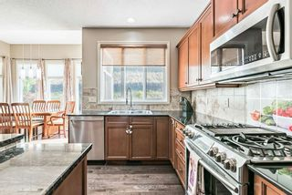 Photo 10: 157 Springbluff Boulevard SW in Calgary: Springbank Hill Detached for sale : MLS®# A1129724