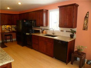 Photo 5: 102 LOCK Crescent: Okotoks Residential Detached Single Family for sale : MLS®# C3511006