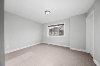 Photo 17: 5 Cougar Ridge Mews SW in Calgary: Cougar Ridge Row/Townhouse for sale : MLS®# A1105171