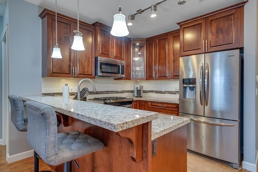 """Main Photo: 107 8067 207 Street in Langley: Willoughby Heights Condo for sale in """"Yorkson Creek - Parkside 1"""" : MLS®# R2584812"""