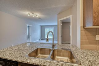 Photo 3: 412 20 Kincora Glen Park NW in Calgary: Kincora Apartment for sale : MLS®# A1144982