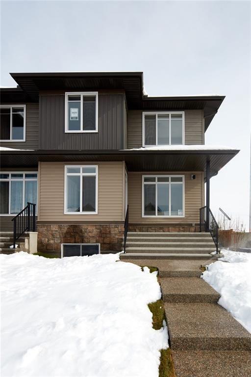 Main Photo: 9020 52 Street NE in Calgary: Saddle Ridge Semi Detached for sale : MLS®# C4209406