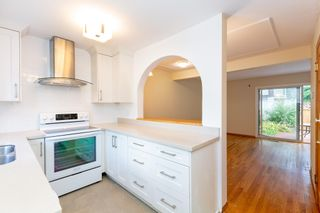 Photo 1: 3254 GANYMEDE Drive in Burnaby: Simon Fraser Hills Townhouse for sale (Burnaby North)  : MLS®# R2604468