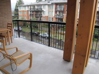 "Photo 11: 310 1150 KENSAL Place in Coquitlam: New Horizons Condo for sale in ""Thomas House"" : MLS®# R2024529"