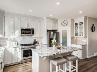 Photo 4: 35 Wolf Hollow Way in Calgary: C-281 Detached for sale : MLS®# A1083895