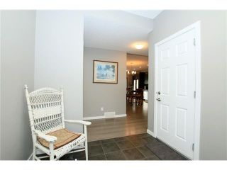 Photo 3: 510 RIVER HEIGHTS Crescent: Cochrane House for sale : MLS®# C4074491
